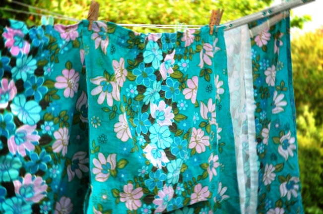 retro floral gren and blue laundry on clothing line