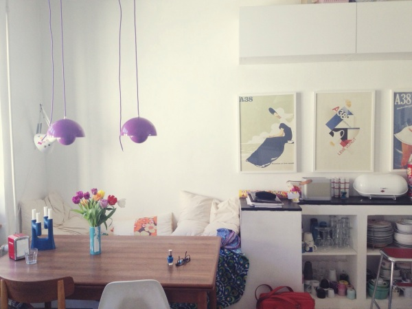 Scandinavian kitchen with purple Verner Panton pendants