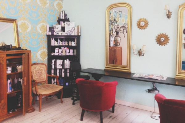 eclectic hairdresser's with red chairs