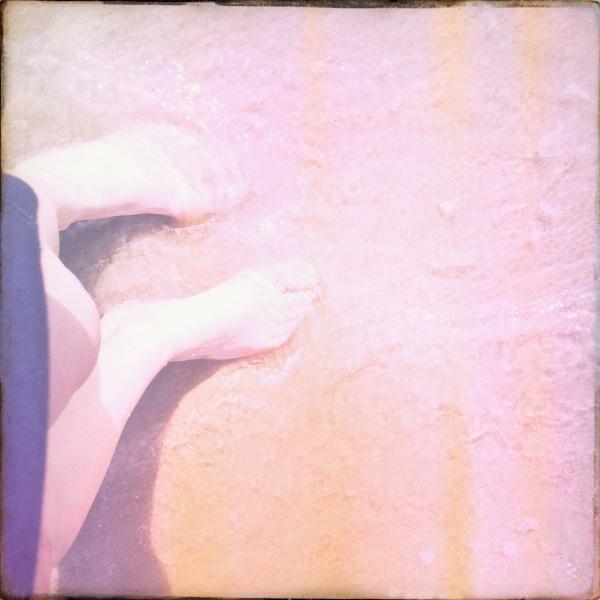 summer feet on sandy beach