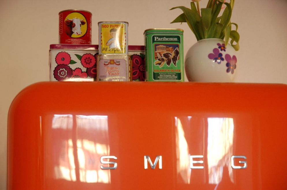 Orange retro smeg with tin cans