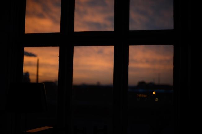 Blurred pink sky through window