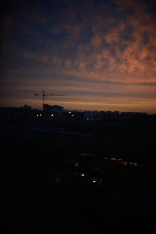 Sunrise overe Vesterbro, Copenhagen. Citylights and dark silhouettes.